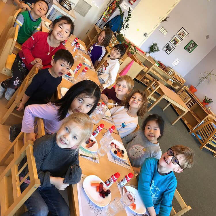Family Montessori classroom photo at snack time